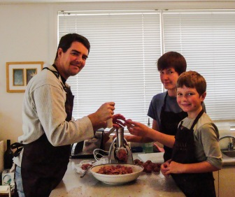 Stuart, #1 and #3 stepson and our original $40 meat grinder. It seems so small now.